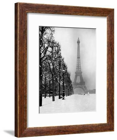 Heavy Snow Blankets the Ground Near the Eiffel Tower-Dmitri Kessel-Framed Premium Photographic Print