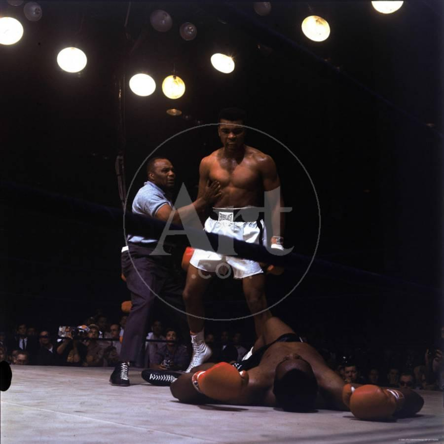 Heavyweight boxer cassius clay aka muhammad ali standing over opponent sonny listonby george silk