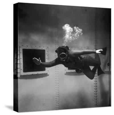 A Scuba Diver Inside a Large Metal Water Tank. Photograph by Heinz Zinram