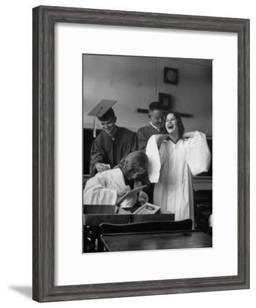 Hempstead High School Seniors Happily Helping Each Other with Graduation Gowns Before Commencement-Gordon Parks-Framed Premium Photographic Print