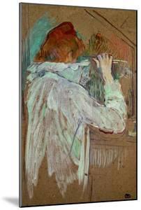 Woman Curling Her Hair by Henri de Toulouse-Lautrec