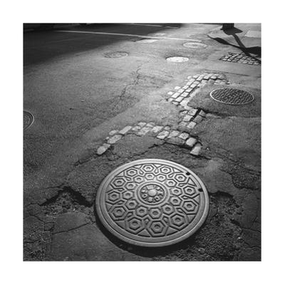 Manhattan Street Manhole Cover by Henri Silberman