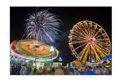 Nc State Fair Rides and Fireworks at Night by Henri Silberman
