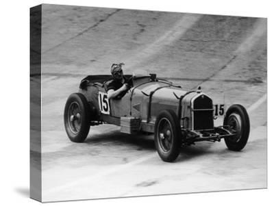 Henry Birkin in an Alfa Romeo at Brooklands, Surrey, 1930S