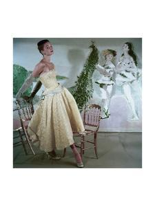 Model Wearing a Strapless Short Evening Dress- Fitted to the Hips by Henry Clarke