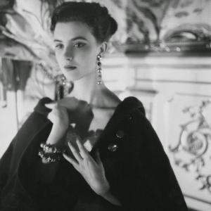 Signorina Illaria Occhini, Actress, Hands on Chest, Wearing Long Earrings and a Dark Cape by Henry Clarke