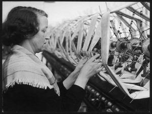 A Woman Working in a Silk and Rayon Mill, Burnley, Lancashire, Britain by Henry Grant
