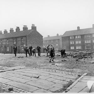 Children in a Deserted Liverpool Street Throw Bricks and Rubble by Henry Grant