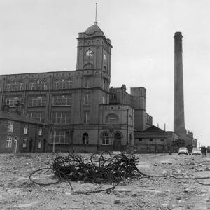 Exterior View of the Firs Mill Textile Factory, Leigh, Lancashire by Henry Grant