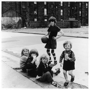 Group of Girls in an East Glasgow Street, Scotland by Henry Grant