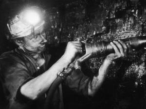 Miner Using an Hydraulic Drill at the Coal-Face, at Cape Bank Hall Pit, Burnley, in Lancashire by Henry Grant