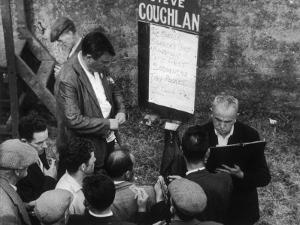 Punters Collect their Winnings from a Bookmaker at Dingle Racecourse, County Kerry, Ireland by Henry Grant