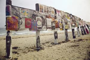 Display of Posters Mounted on Pilings in the Sand, Montauk Point, Long Island, New York, 1967 by Henry Groskinsky