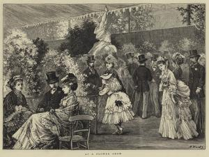 At a Flower Show by Henry Woods