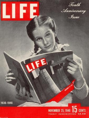 10th Anniversary Features Young Girl Reading First Issue of LIFE, November 25, 1946