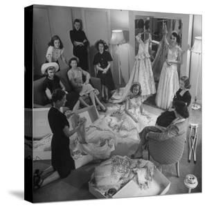 Debs of Omaha Aspire to be Queen: Last Years Queen and Her Court Look over Ballgowns by Herbert Gehr