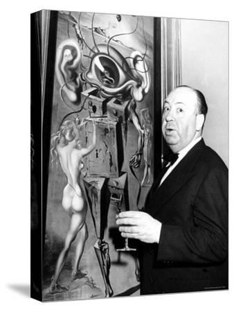 """Film Director Alfred Hitchcock, Standing Beside Salvador Dali's Painting """"Movies"""""""
