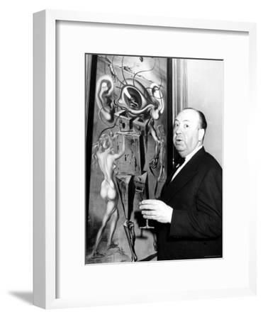 "Film Director Alfred Hitchcock, Standing Beside Salvador Dali's Painting ""Movies"""