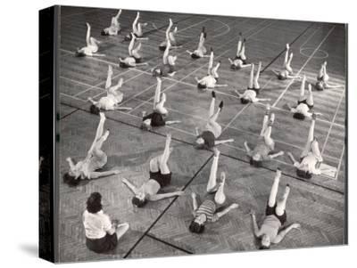Girls and Women Doing Leg Exercise on Floor of Metropolitan Life Insurance Company's Gym