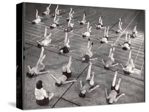 Girls and Women Doing Leg Exercise on Floor of Metropolitan Life Insurance Company's Gym by Herbert Gehr