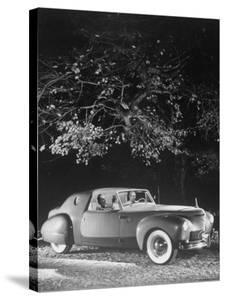 Industrial Designer Raymond Loewy at the Wheel of Costly Experimental Lincoln Continental Dream Car by Herbert Gehr