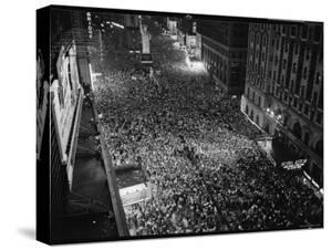 Night View of People Jammed into Times Square Celebrating the End of the War in Europe by Herbert Gehr