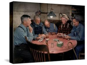 Old Gold Miners Play a Game of Poker at Twilight, Volcano Grocery Store, Volcano, California, 1948 by Herbert Gehr