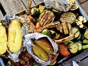 Barbecued Vegetables, Baked Potatoes, Lamb Chops on Barbecue Tray by Herbert Lehmann