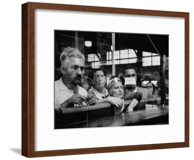 Here Waiting Faces Mirror Anxiety as They Hear List of the Survivors of Sinking Ship Andrea Doria-Gordon Parks-Framed Premium Photographic Print