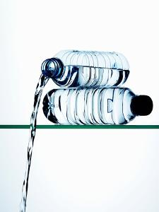 Water Running Out of a Plastic Bottle by Hermann Mock