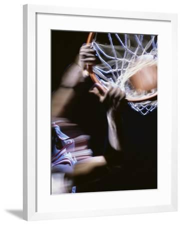 High Angle View of a Man Slam Dunking--Framed Photographic Print
