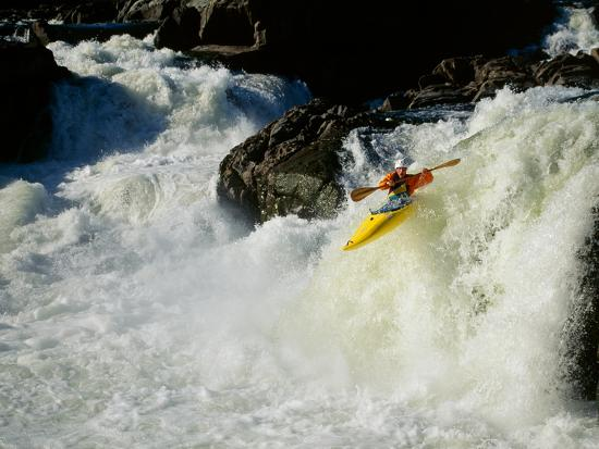 High angle view of a person kayaking in rapid water--Photographic Print
