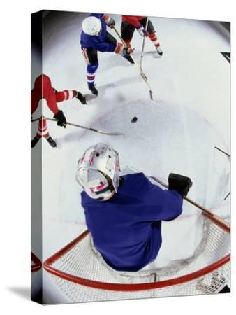 High Angle View of Ice Hockey Players Surrounding The Goal