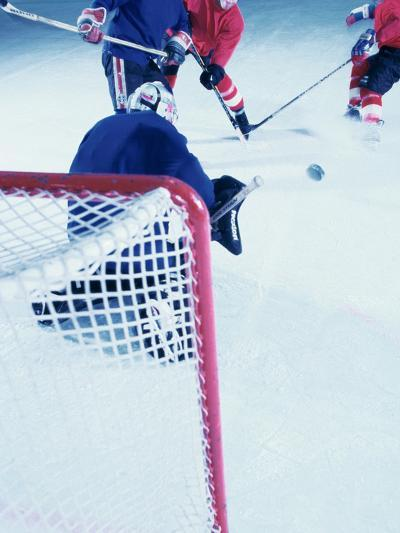 High Angle View of Ice Hockey Players Surrounding The Goal--Photographic Print