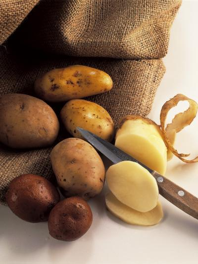 High Angle View of Raw Potatoes with a Knife-P^ Martini-Photographic Print