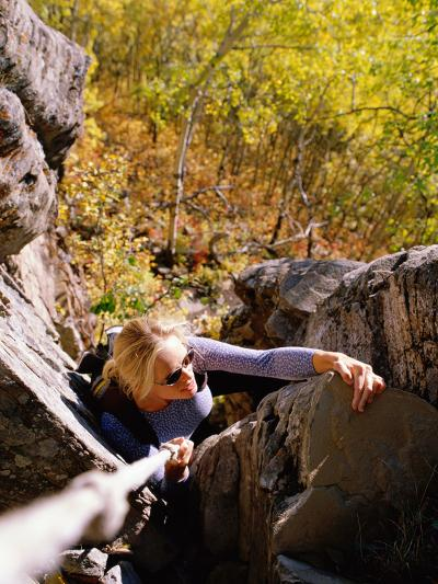 High Angle View of Young Woman Rock Climbing--Photographic Print
