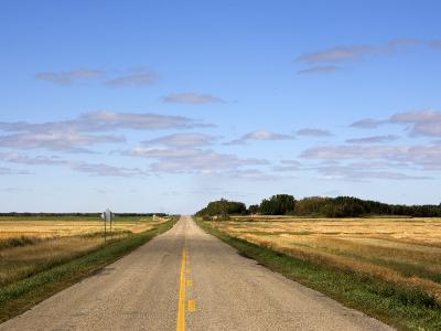 Highway on the Manitoba-Saskatchewan Border-Pete Ryan-Photographic Print