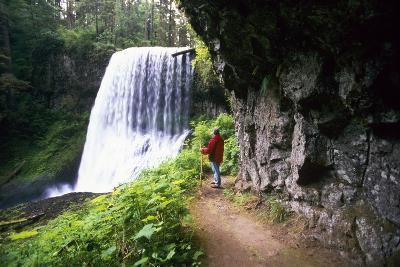 Hiker Looking at Waterfall-Craig Tuttle-Photographic Print
