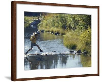 Hiker on Stepping Stones--Framed Photographic Print