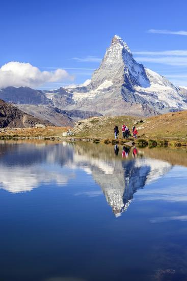 Hikers Walking on the Path Beside the Stellisee with the Matterhorn Reflected-Roberto Moiola-Photographic Print