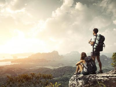 Hikers With Backpacks Enjoying Valley View From Top Of A Mountain-Dudarev Mikhail-Art Print