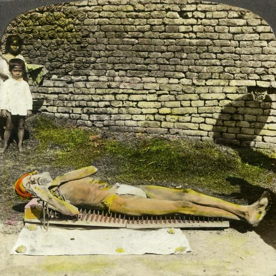 Hindu Devotee on a Bed of Nails Near the Shrine of Kali, Calcutta, India, Early 20th Century-Underwood & Underwood-Giclee Print