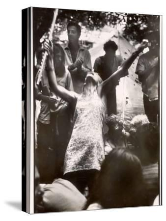Hippie Girl Enthusiastically Playing Flute and Dancing at Woodstock Music Festival