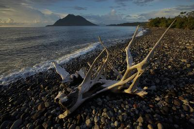 Hiri Island Viewed from a Volcanic Rock Beach on Ternate Island, Indonesia-Timothy Laman-Photographic Print
