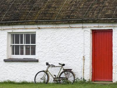 Historic Thatched Roof House with a Red Door and Old Bicycle-Rich Reid-Photographic Print