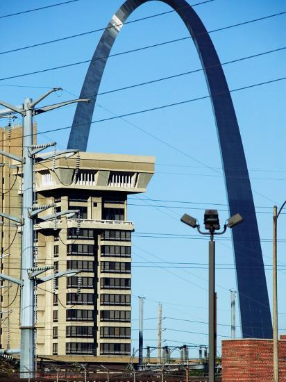 Historical Gateway Arch Towering over Building in St. Louis, Missouri--Photographic Print
