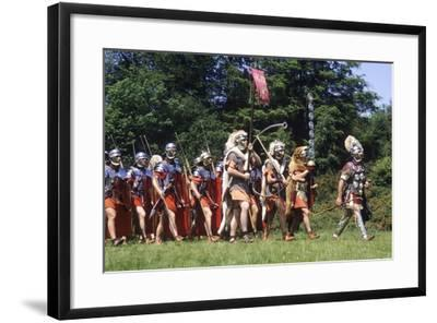 Historical Re-Enactment of a Roman Centurion Leading Soldiers--Framed Photographic Print