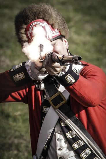 Historical Reenactment: British Soldier Firing Muzzle-Loading Flintlock Rifle. American Revolutiona--Photographic Print