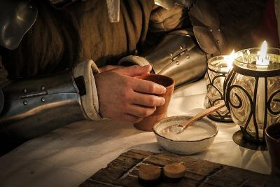 Historical Reenactment: Soldier at Table in Tavern, 14th Century--Photographic Print