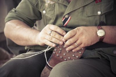 Historical Reenactment: Wehrmacht Soldier Repairing Sole of Military Boot--Photographic Print